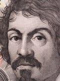 Caravaggio在100000意大利里拉面对钞票关闭  一  库存图片