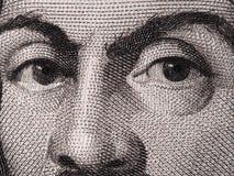 Caravaggio смотрит на на 100000 итальянских банкноты лирах макроса крайности Стоковые Изображения RF