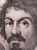 Caravaggio face on 100000 italian lire banknote close up. One of Stock Image