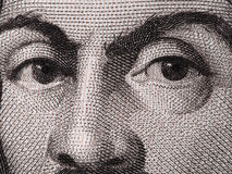 Caravaggio font face sur 100000 Lires italiennes de billet de banque de macro d'extrémité Images libres de droits