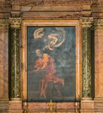 Caravaggio, `The Inspiration of Saint Matthew`, in the Church of Saint Louis of the French in Rome, Italy. The Church of St. Louis of the French is a Roman Royalty Free Stock Image