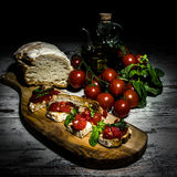 Caravaggio's light in still life Stock Images