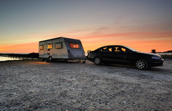 Caravan. Car with caravan late one evening with the suns last light Stock Photography