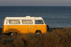 Caravan. A seascape with a yellow old fashioned van Stock Photo
