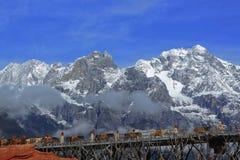 Caravan across Jade Dragon snow mountain Stock Photos