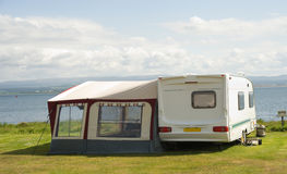 Caravan with awning. An image of a caravan, of the type towed by a car, with an awning providing additional living space stock photography