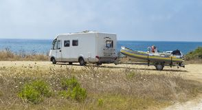 Summer holidays by the sea. Caravan boat summer time, holidays by the sea stock images
