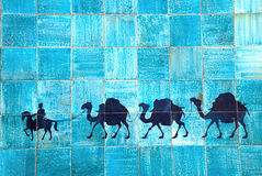 Caravan of camels on the ceramic tiles Royalty Free Stock Photos