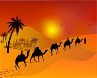 Caravan camels going through the desert. east. Muslim landscape. Stock Photography