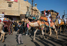 Caravan of camels and safari riders Royalty Free Stock Photos