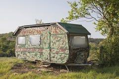 Caravan in camouflage look stock photography