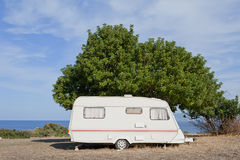 Caravan on camping by the sea Stock Photography