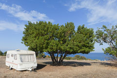 Caravan on camping by the sea Stock Image