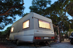 Caravan on a camping site Royalty Free Stock Photo