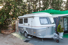Caravan on a camping site Stock Images