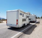 Caravan car moving by the sea in summer season. Holidays stock photography