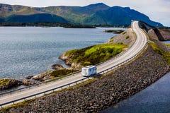 Caravan car RV travels on the highway Atlantic Ocean Road Norway. Caravan car RV travels on the highway Norway. Atlantic Ocean Road or the Atlantic Road royalty free stock image
