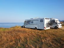 Caravan car summer holidays by the sea. Sunny morning royalty free stock photography