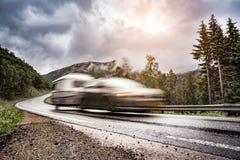 Caravan car trailer travels on the highway. Stock Image