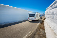 Caravan car travels on the highway. Royalty Free Stock Image