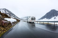 Caravan car travels on the highway. Beautiful Nature Norway natural landscape Stock Photos