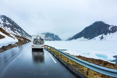 Caravan car travels on the highway. Beautiful Nature Norway natural landscape Stock Photography