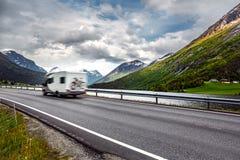 Caravan car travels on the highway. Stock Image