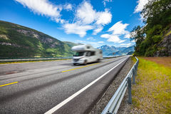 Caravan car travels on the highway. Stock Images