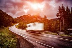 Caravan car travels on the highway. Stock Photos
