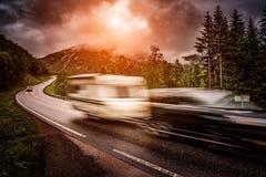 Caravan car travels on the highway. Royalty Free Stock Photos