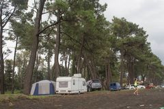 Caravan, cars and tent covered. Tourists on holiday in forest, setting a tent covered. Travel or sea vacations concept Stock Photography