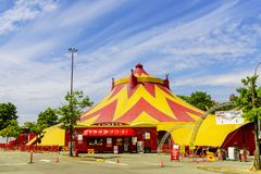 Caravan circus in the city, green trees, cars in a parking lot, royalty free stock images