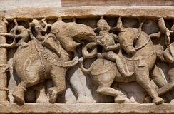 Caravan of elephants on wall of temple in India Stock Photos