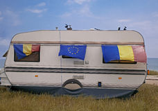 Caravan with flags. Caravan at the see  with UE and romania flags Stock Images