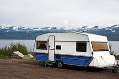 Caravan holiday. Caravan parked at a lake in Norway Stock Image