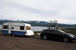 Caravan holiday. Caravan parked at a lake in Norway Stock Photo