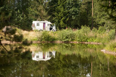 Caravan at a lake in summer Stock Image