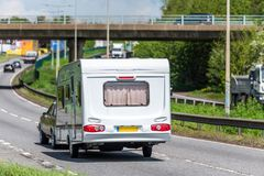 Caravan motorhome on uk motorway in fast motion.  stock photos