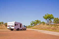 Caravan in Outback Australia. A typical Outback touring rig heads back onto the road at a Western Australian rest area stock photography