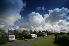 Caravan park. Touring caravans on a park royalty free stock images