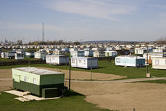 Caravan Park. With telephone transmitter in the distance. Old Green caravan in foreground Stock Image