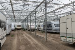 Caravan parking in empty Dutch Greenhouse royalty free stock image