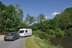 Caravan passing a lake Royalty Free Stock Photography
