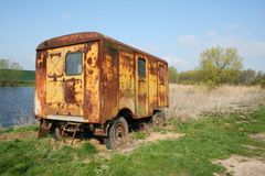 Caravan by the pond Royalty Free Stock Photos