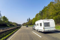 Caravan or recreational vehicle motor home trailer on a freeway Stock Image