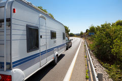 Caravan in the road Stock Photos