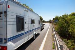 Caravan in the road stock photos