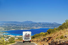 Caravan on the road at the mediterranean shore Stock Photo