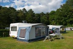 Caravan and shelter at the camping Royalty Free Stock Image