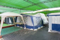 Caravan and tents at a campground Stock Images